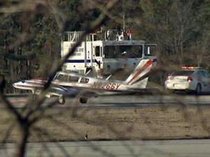A twin-engine Piper aircraft experiencing mechanical problems skidded off a runway at Raleigh-Durham International Airport on Feb. 21, 2009.