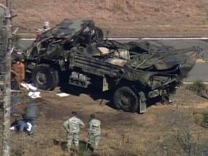 Army crews clear the wreckage of a truck that overturned on Fort Bragg on Feb. 24, 2009.