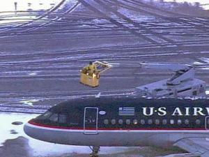 Crews de-ice a US Airways jet at Raleigh-Durham International Airport on Monday morning after an overnight snowfall.