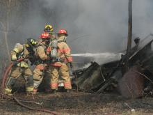 Fuquay-Varina firefighters battle a blaze in an abandoned mobile home at 6400 Mims Road on Saturday, March 6, 2009. No one was injured in the two-alarm fire. (Photo/Thomas Babb)