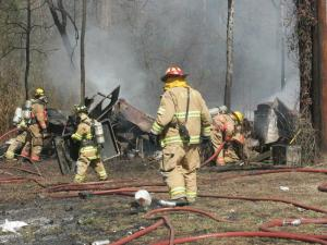 Fuquay-Varina and Holly Springs Fire departments battle this trash and moblie home fire on 6400 Mims Road on Saturday, March 6, 2009. No one was injured. The mobile home was totally destroyed. (Photo/Thomas Babb)