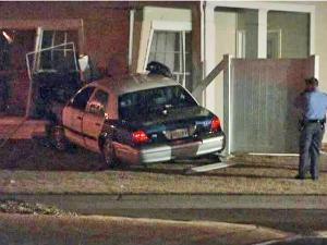 A patrol car crashed into a home at 8041 Satillo Lane in north Raleigh around 11p.m. Saturday, Raleigh police said.