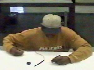 A surveillance image of the suspect in the robbery of Wachovia Bank, 2001 Clark Ave., on March 10, 2009.