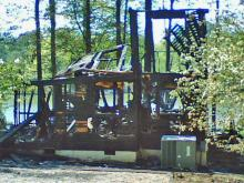 Two homes burned on Pine Wood Court in the Lake Shore in Littleton, off Lake Gaston, early Friday, April 24, 2009. The Halifax County Sheriff's Office was investigating two cases of arson, three break-ins and one attempted break-in at homes on the cul-de-sac that night.