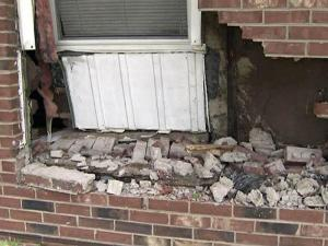 A car slammed into the house at 437 Solar Drive in Raleigh on April 29, 2009, before speeding off. No one was home at the time.