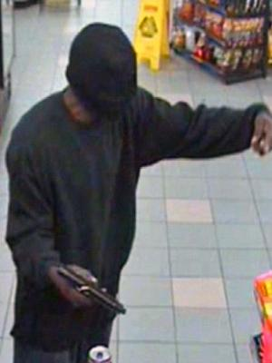 A surveillance photo of the suspect in the May 5, 2009 robbery of the Kangaroo convenience store, 4604 North Roxboro Road in Durham.