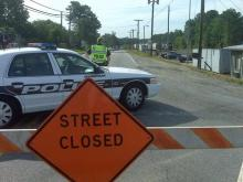 Durham police block off Angier Avenue, where  haz-mat crews responded to a chemical leak from a train car in a railroad yard, between Carter Avenue and Ellis Road, Friday, May 22, 2009.