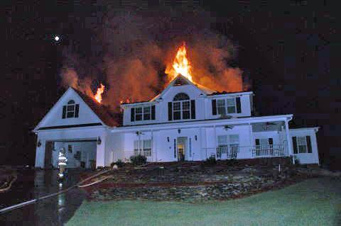 A firefighter was hospitalized after the ceiling of burning home at Countess Court in Whispering Pines around 2:30 a.m. Tuesday, June 9, 2009. (Photo courtesy of Frank Stanley, Circle V Fire Station in Vass)