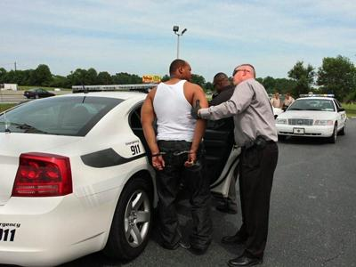 Authorities arrested two men Wednesday afternoon in Princeton after a robbery at the RBC Centura Bank in Zebulon. (Photo courtesy of Gray Whitley)