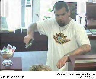 The Federal Bureau of Investigation and Fayetteville police have joined the investigation of a June 19 bank robbery in Mount Pleasant, S.C. Police released surveillance photos of the bank robber showing a white man with brown facial hair and extensive tattoos on both forearms.