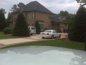 Authorities surrounded the Olde Raleigh home of William Wise Monday.