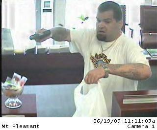 Police are looking for this man, who is suspected of robbing at least five banks in North and South Carolina.