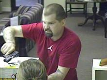 A bank security camera shows a man police believe is responsible for six bank robberies in North and South Carolina since mid-May.