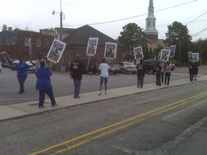 Protesters marched in support of Fayetteville's Haymount Station Post Office Friday.