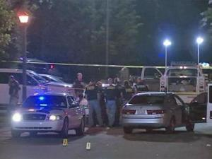 Police cars surround the Cracker Barrel restaurant at 3703 Hillsborough Road, off Interstate 85, in Durham after a shooting Wednesday night, Sept. 2, 2009.
