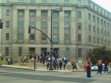 Department of Justice employees and visitors waited on the street Thursday. (Photo submitted by: Dolly Sickles)