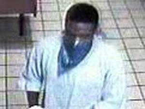 A surveillance image of the man who robbed the Italian Pizzeria, 3500 North Roxboro Road in Durham, on Sept. 15, 2009.