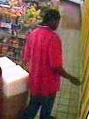 A surveillance photo of the suspect in a theft and assault at Family Fare BP, 2685 Chapel Hill Blvd. in Durham, on Sept. 21, 2009.