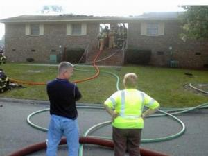 Firefighters put out a fire at the North Point Apartments on Pinecrest Street in Spring Lake on Sunday, Sept. 27, 2009. (Photo from WRAL viewer)