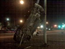 A wreck in Raleigh early Thursday ended with the driver in jail and his car standing upright.