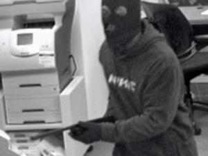 A photo taken from a surveillance camera of a bank robbery suspect at the SunTrust Bank at 3620 Six Forks Road in Raleigh.