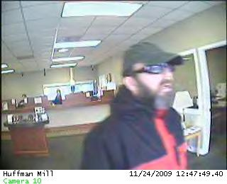 A surveillance camera captured this image of an alleged bank robber in Burlington Tuesday.