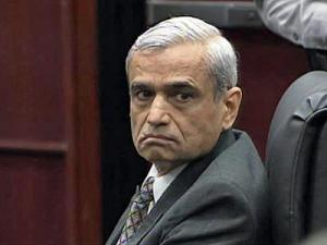 Harish Patel sits in a Wake County courtroom Nov. 30, 2009, the first day of his murder trial. Patel is accused of killing his estranged wife, Vanlata Patel, and setting her body on fire along a Virginia highway on Jan. 16, 2008.