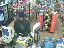 Surveillance video shows a man robbing a Kangaroo convenience store.