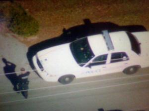 A photo taken from Sky 5 show police searching for a gunman who shot at a Hope Mills police car on Dec. 1, 2009.