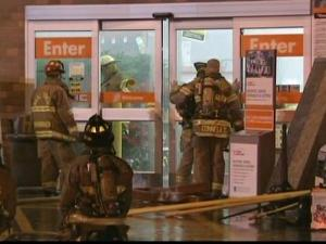 Firefighters investigate a fire at the Home Depot at 11915 Retail Drive in Wake Forest on Wednesday, Dec. 2, 2009.