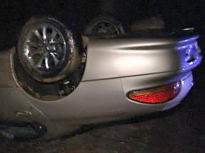 Troopers say a driver was going too fast in the rain when he wrecked on Interstate 40 near Harrison Avenue early Wednesday, Dec. 9, 2009.