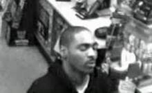 Chapel Hill police are asking for the public's help to identify a man caught on surveillance cameras robbing the Kangaroo Express convenience store, at 1501 E. Franklin St., early Wednesday, Dec. 9, 2009.