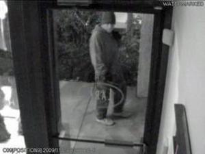 A surveillance photo shows a man who Chapel Hill police broke into the Purple Puddle and Cafe Parvaneh in South Elliot Street shopping center early Nov. 29. Two other businesses in the shopping center were broken into earlier in the month.