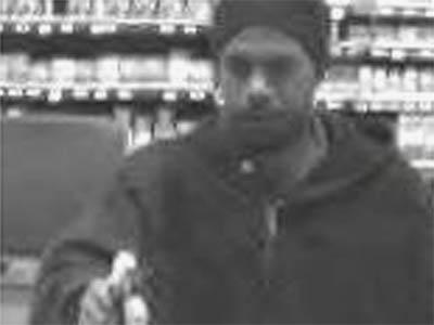 Cary police were searching for a man who robbed the SunTrust Bank inside the Harris Teeter grocery store at 2741 N.C. 55 on Dec. 17, 2009.