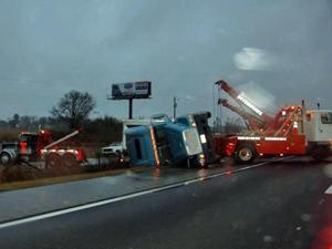 The tractor trailer and SUV collided Friday afternoon on Interstate 95, near the Pope Road overpass, in Harnett County.