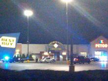 Police tape surrounds an entrance to Rocky Mount's Golden East Crossing Mall, at 1100 N. Wesleyan Blvd., after a shooting Saturday, Dec. 26, 2009.