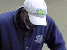 A surveillance photo of the suspect in the robbery of Mechanics and Farmers Bank at 116 Parrish St. in Durham on Feb. 9, 2010.