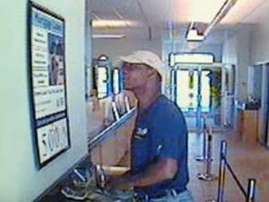 A surveillance photo of a bank robbery suspect sought in the robbery of the Research Triangle Park Credit Union on Feb. 11, 2010.