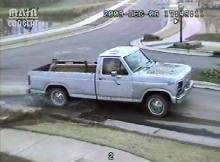 Cary police released a surveillance photograph and video showing a gray pick-up loaded with a bucket loader driving away from a construction site on O'Kelly Chapel Road on Dec. 6, 2009. Bradley Lane Tucker, 28, of Stem was charged with felony larceny.