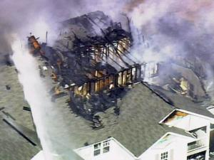 Granville County firefighters battle a fire at the Granville Oaks Apartments complex in Creedmoor on March 4, 2010.