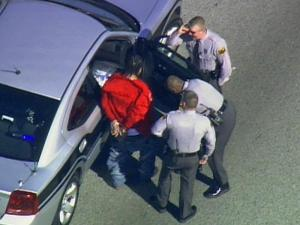 State troopers surround a suspect after a high-speed chase Friday on Interstate 85.
