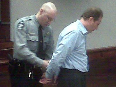 A Wake County deputy takes Apex Construction owner Michael Luchansky into custody on March 8, 2010. Luchansky was found in contempt of court for not repaying a homeowner for an incomplete renovation job.