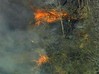 Crews were fighting a brush fire in a wooded area between Fayetteville and Robertson streets in Knightdale on March 9, 2010.