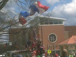 Firefighters rescue parachutist Dave Lillico from a tree in downtown Raleigh. Crosswinds blew his team off course during a jump for a St. Patrick's Day celebration on Saturday, March 13, 2010, and Lillico's chute got caught in a tree above Martin Street.