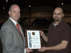 Sam Matheny (left), chairman of the board of the Triangle Area Chapter of the American Red Cross, honored local businesses and organizations for their fund-raising efforts.