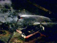 Sky 5 flies over neighborhood fire