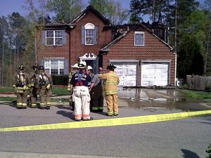 Firefighters respond to a house fire on the 300 block of Grassy Point Road in Apex on Monday, April 5, 2010.
