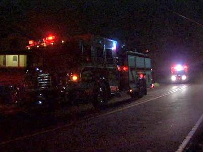Firefighters battled a blaze in a wooded area off S. Mineral Springs Road in Durham early Tuesday.