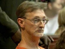 William Jackson Neal Jr. sits in court in April 2010 while on trial for the 1987 rape of a then-12-year-old Goldsboro girl.