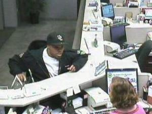 Surveillance photos show a man robbing the BB&T branch at 1114 Benvenue Road in Rocky Mount around 1:40 p.m. on April 28, 2010.